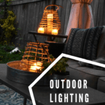 candle lanterns glowing in a dark outdoor living room
