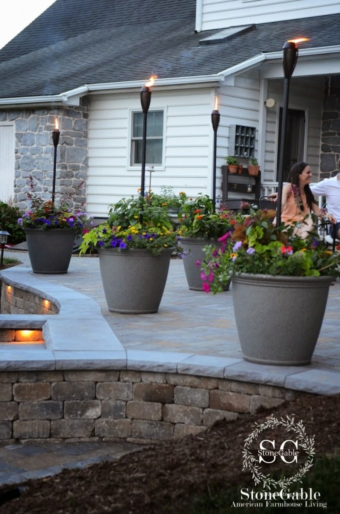 patio with tiki torches in planters