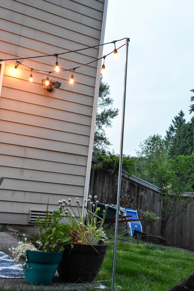 Need to light a deck, patio, or fire pit? Install easy and inexpensive removable string light poles. I'll show you how.