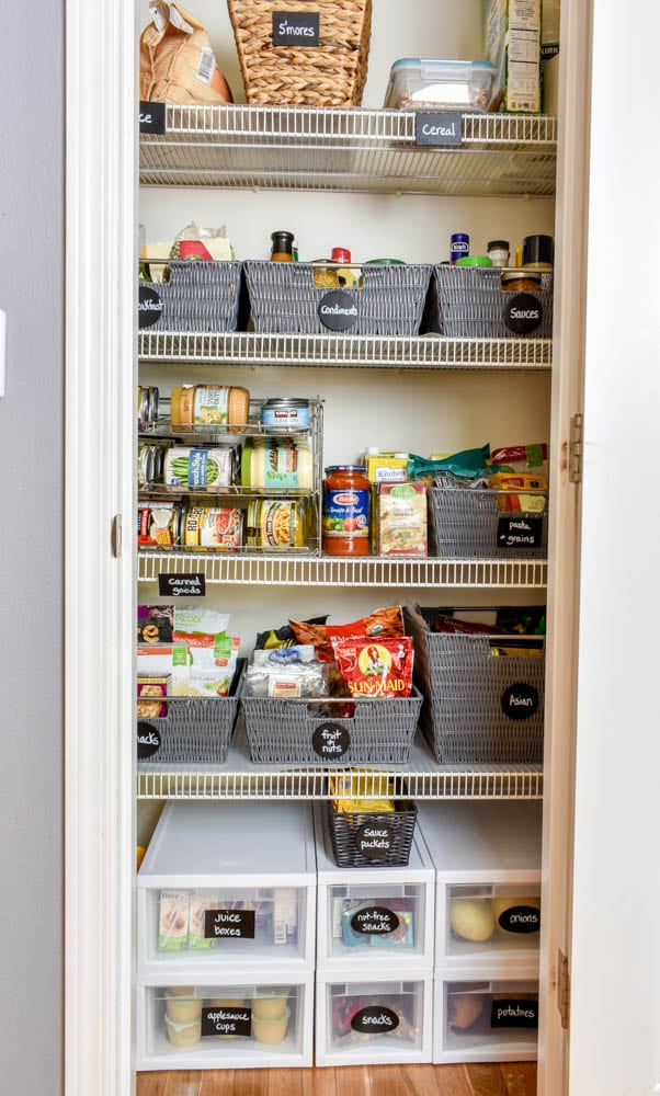 This small organized pantry closet  on a budget with shelves and baskets is full of cheap and easy ideas to keep all your food visible and easy to access!