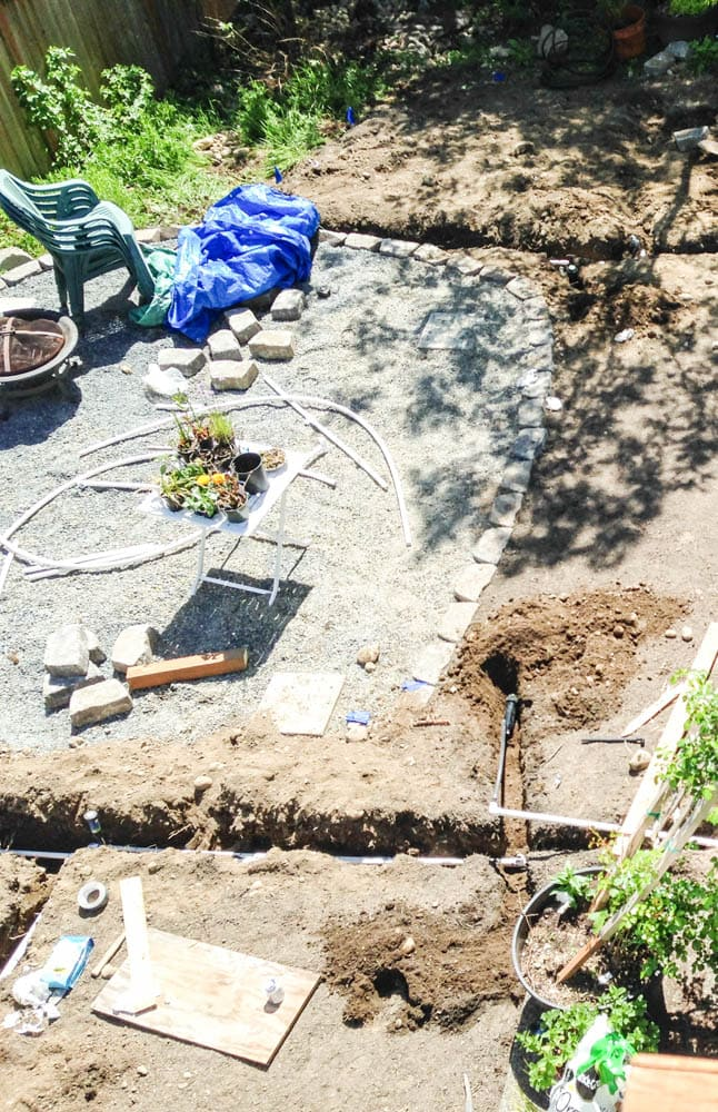 bird's eye view of gravel patio with cement pads ready for installation of costco gazebo from Yardistry