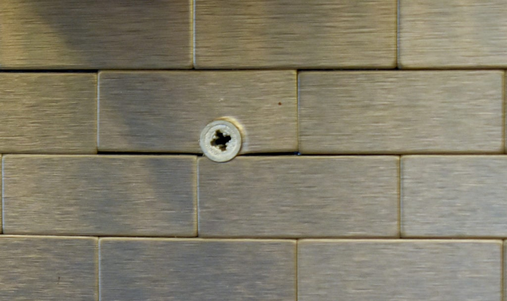 photo of stainless steel backsplash with anchor