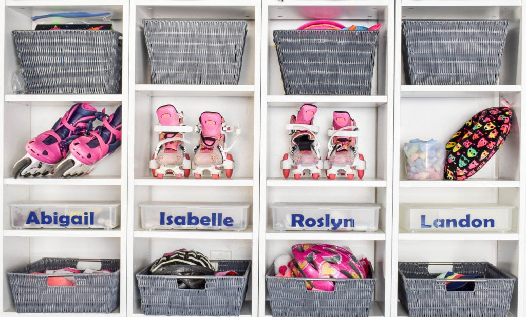 photo of entry cubbies with backpacks & coats