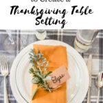 image of Thanksgiving table setting with mustard yellow napkins and fresh herbs