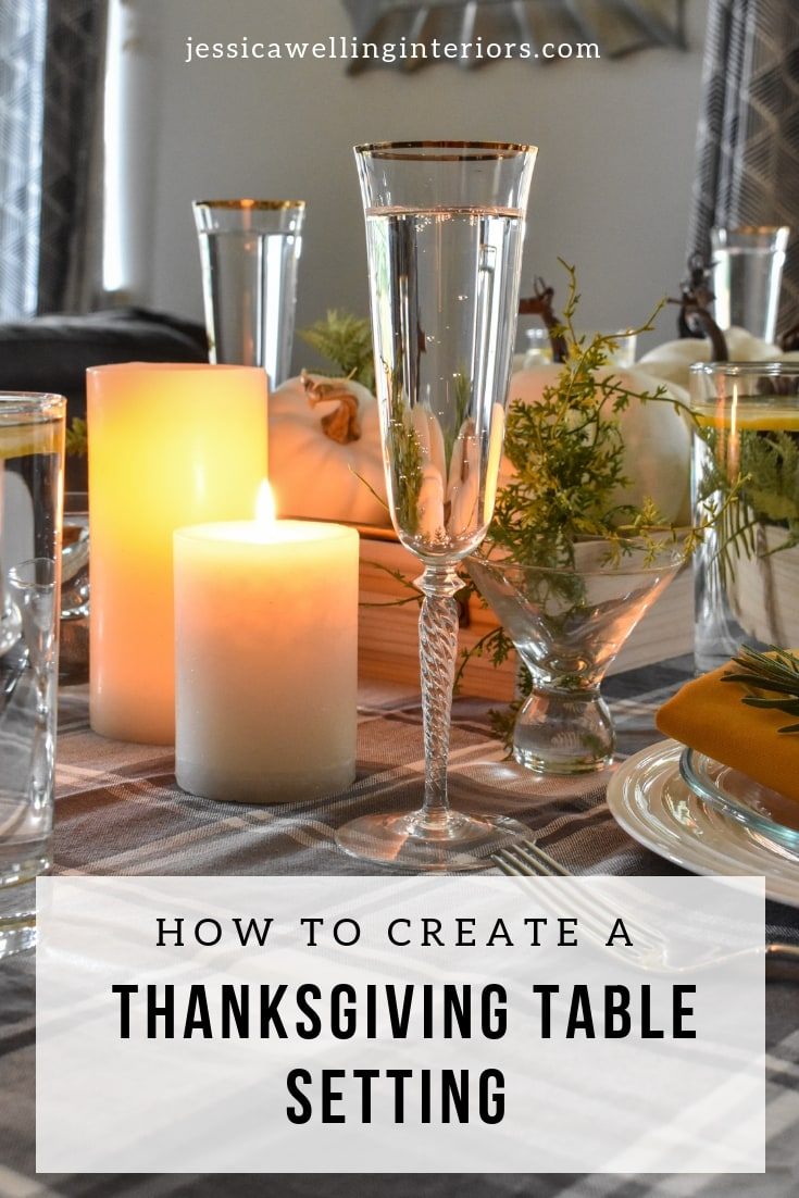 image of Thanksgiving table setting with candles, white pumpkins, & champagne flutes