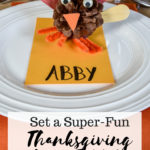 image of Thanksgiving kids table with pine cone turkey