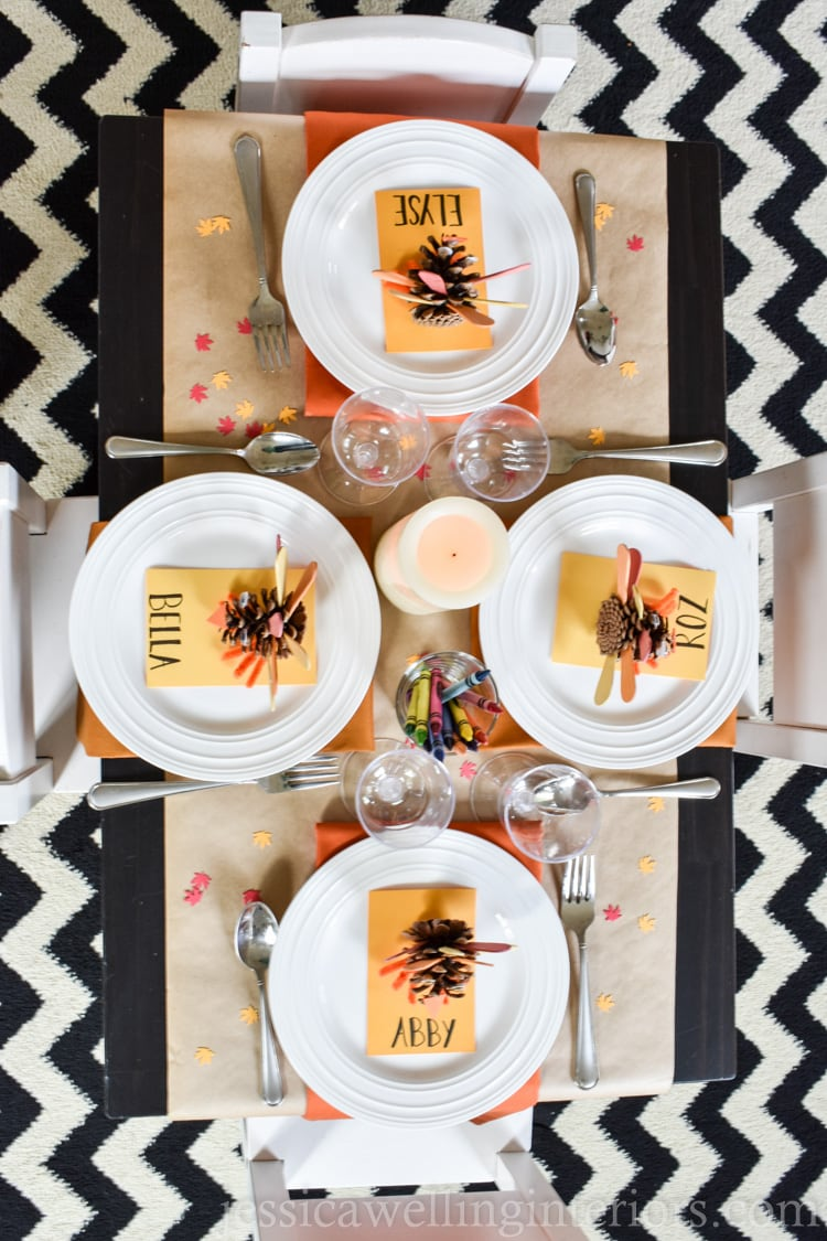 image of thanksigiving kids table with pine come turkeys and crayons