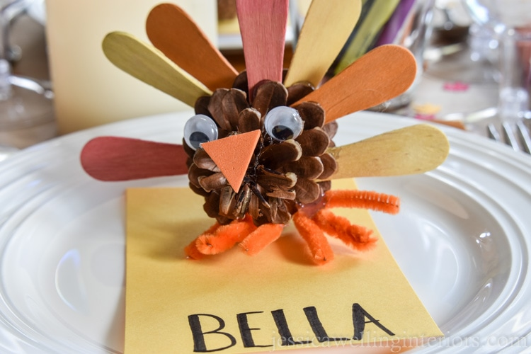 image of pine cone turkey on Thanksgiving kids table