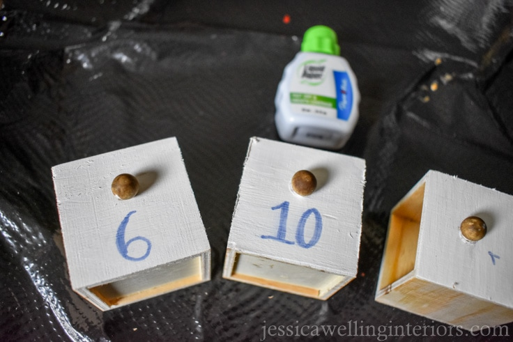 mini drawers from wood advent calendar being painted white