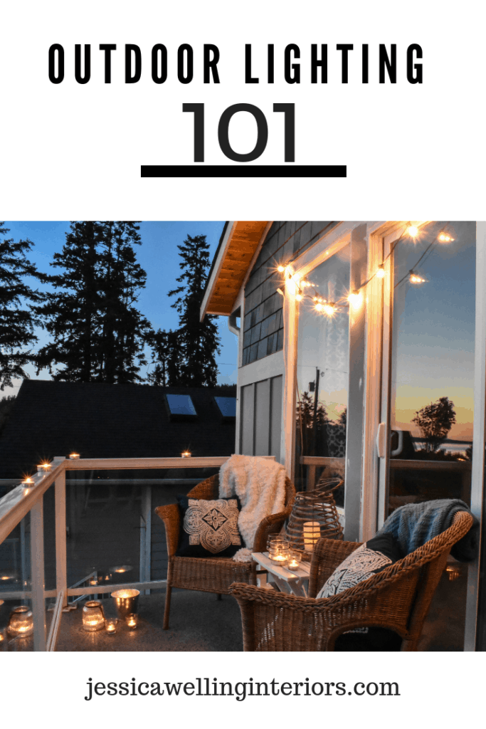 Outdoor Lighting 101: balcony lit by sunset, string lights, and candle lanterns