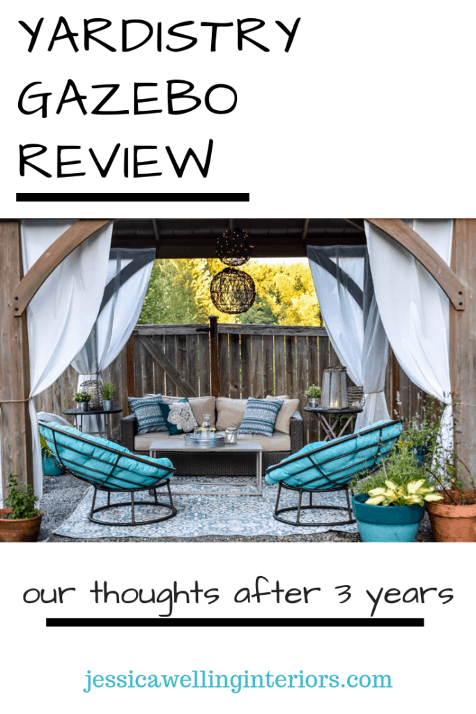 Yardistry Gazebo Review: Our Thoughts After Three Years, jessicawellinginteriors.com Costco gazebo housing outdoor living space with curtains, a rug, and outdoor furniture