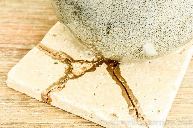 image of mug on end table with kintsugi tile coaster