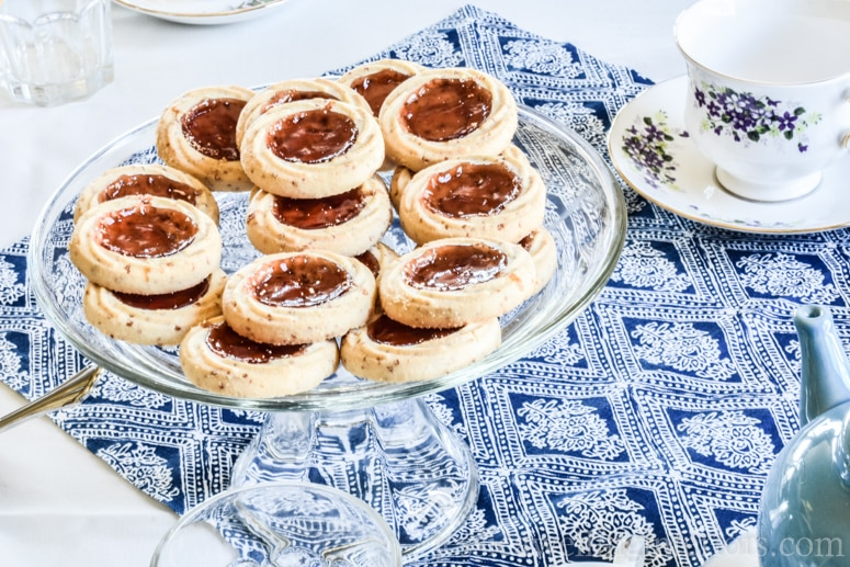 image of blue and white Mother's Day Tea party table setting with jam thumbprint cookies