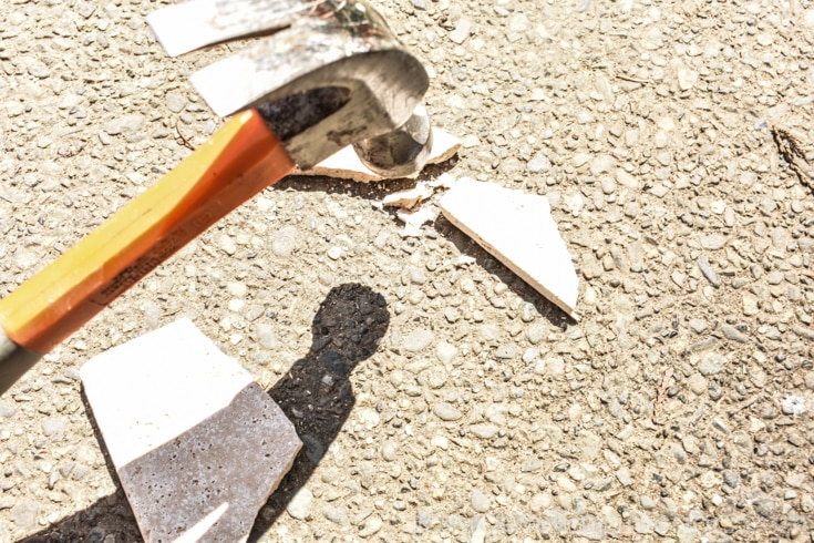 image of hammer breaking tile for kintsugi coasters