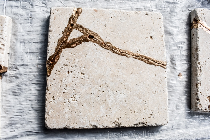 image of kintsugi coaster made from tile and gold leaf paint