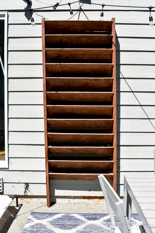 image of wood vertical garden mounted on the side of the house
