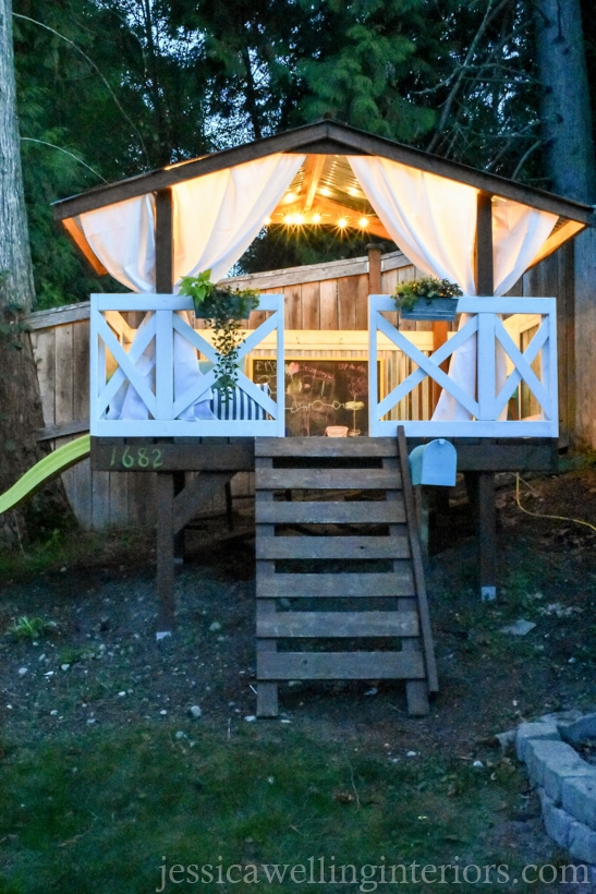 children's playhouse lit with string lights