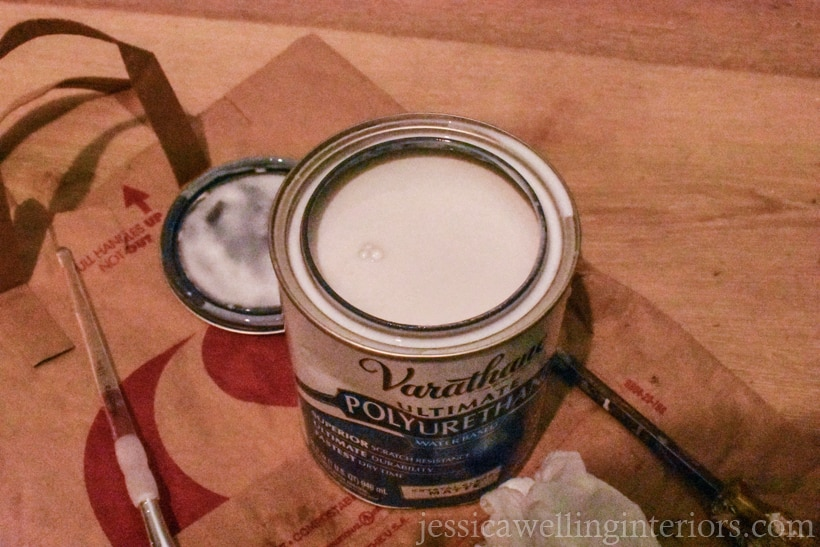 opened can of varathane polyurethane clear coat on the floor