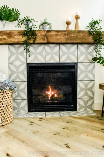 DIY painted faux cement tile fireplace with grey and white stenciled pattern