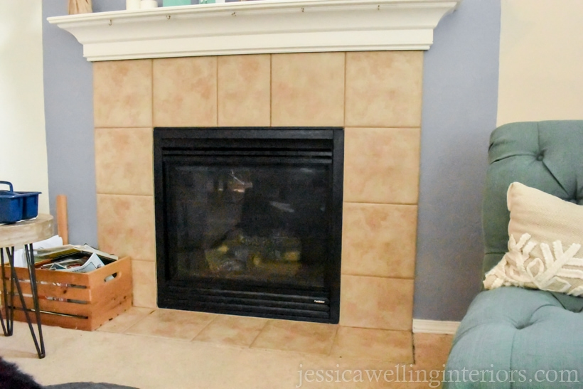 before photo of fireplace- plain contractor fireplace with beige tiles and a white painted mantel