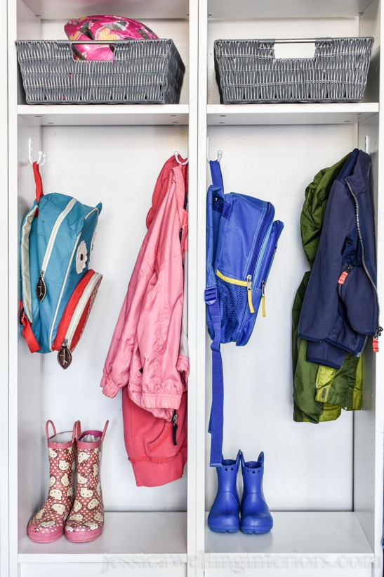 close-up of Ikea Billy bookcase backpack organizer hack. Hooks hold small children's backpacks and coats