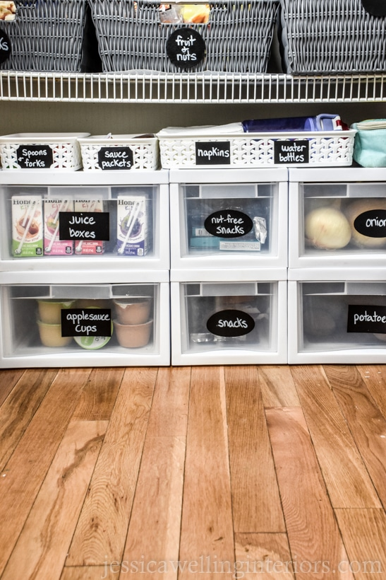 "bottom half of pantry with white plastic drawers with chalkboard sticker labels- ""juice boxes,"" ""nut-free snacks"", etc."