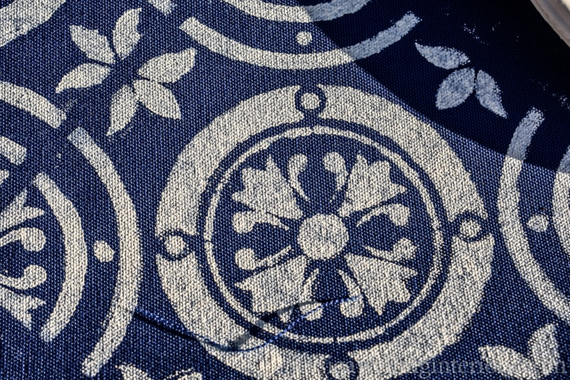 Navy blue outdoor fabric painted with Moroccan tile stencil pattern in white