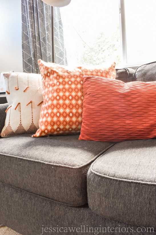 Fall living room decor with orange throw pillows