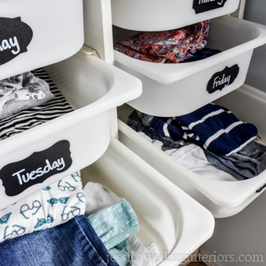 plastic ikea hack drawers with chalkboard labels for the days of the week. Individual outfits are in each drawer