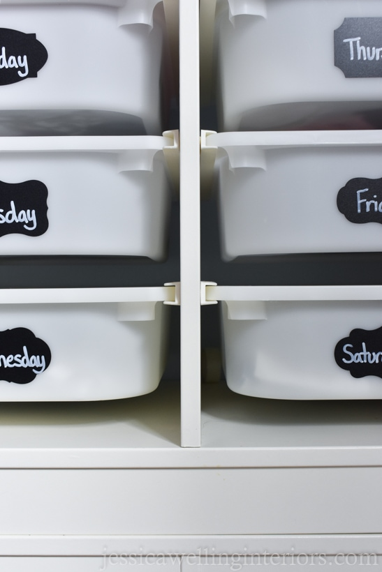 IKEA TROFAST unit, showing six drawer bins, each labeled with a day of the week