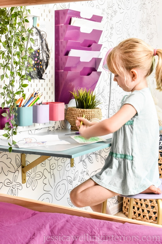 diy floating desk for kids with little girl sitting at it.