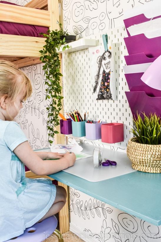 girls bedroom with little girl coloring at diy floating desk