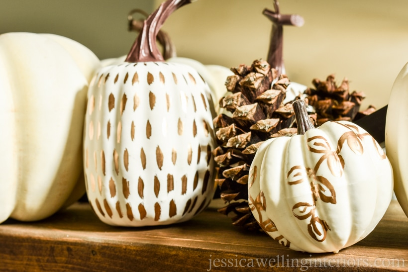 fall decor ideas for the mantel- wood mantel with painted pumpkins and pine cones