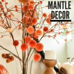 Fall Mantle Decor: close-up of Fall stems with pom-poms on a mantle decorated for Fall