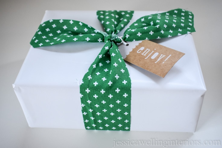 Christmas gift wrapping ideas: white paper gift tied with green patterned fabric ribbon