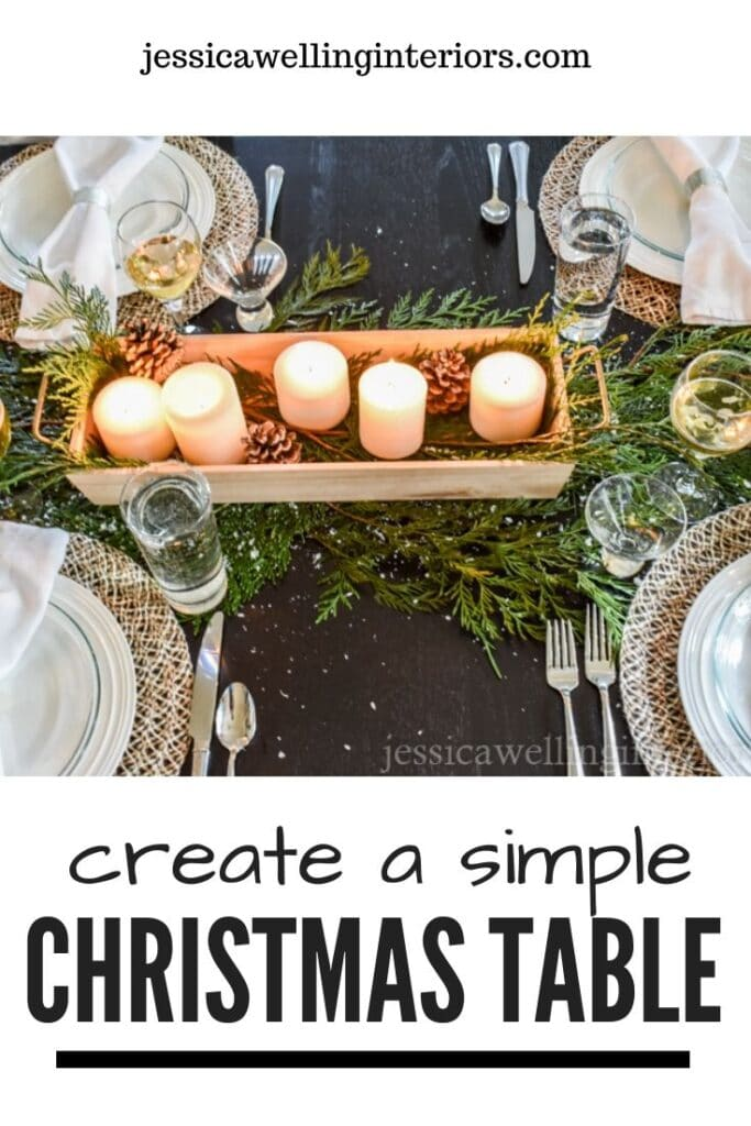 Create a Simple Christmas Table: black table set with cedar boughs and a wood tray of candles as a centerpiece