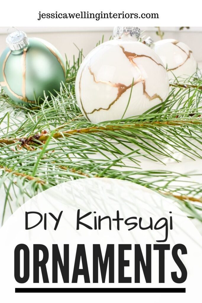 DIY Kintsugi Ornaments: white and aqua colored glass ball ornaments painted with gold leaf paint to look like kintsugi on fir branches