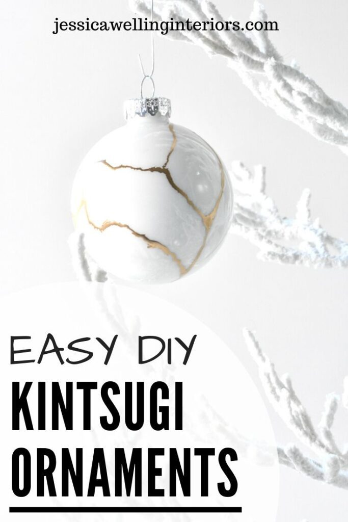 Easy DIY Kintsugi Ornaments: white glass Christmas ornament with gold lines hanging from a white tree
