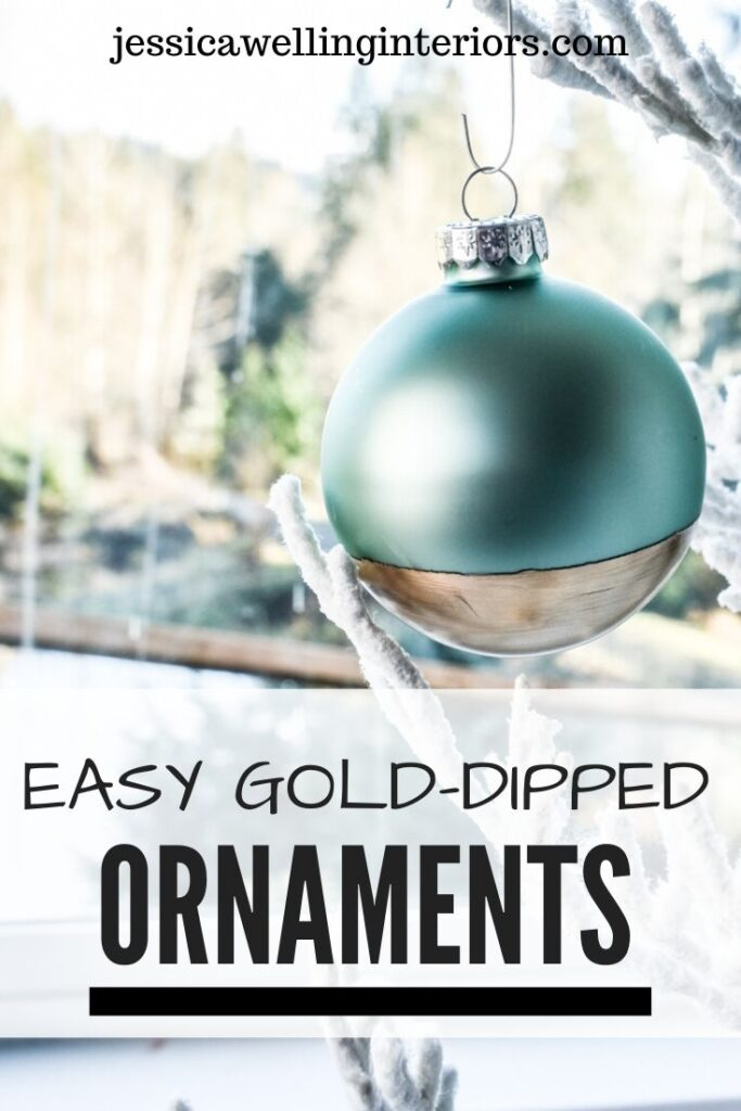 Easy Gold-Dipped Ornaments: aqua glass ball ornament dipped in gold leaf paint in front of a window