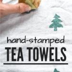 white tea towel with hand using potato stamp to print green Christmas trees on the tea towel