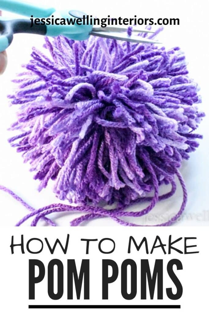 How to Make Pom Poms: close-up of large purple pompom being trimmed with craft scissors