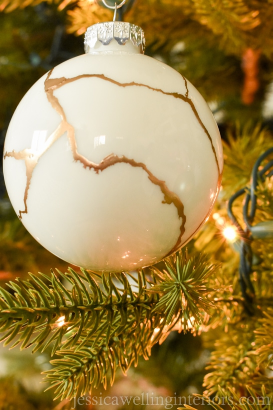 white diy kintsugi ornament hanging from a Christmas tree