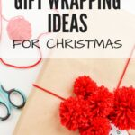 Pompom Gift Wrapping Ideas for Christmas: brown paper-wrapped gift tied with red yarn and topped with several red pom poms