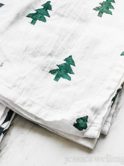 white tea towels with Christmas trees and triangle patterns