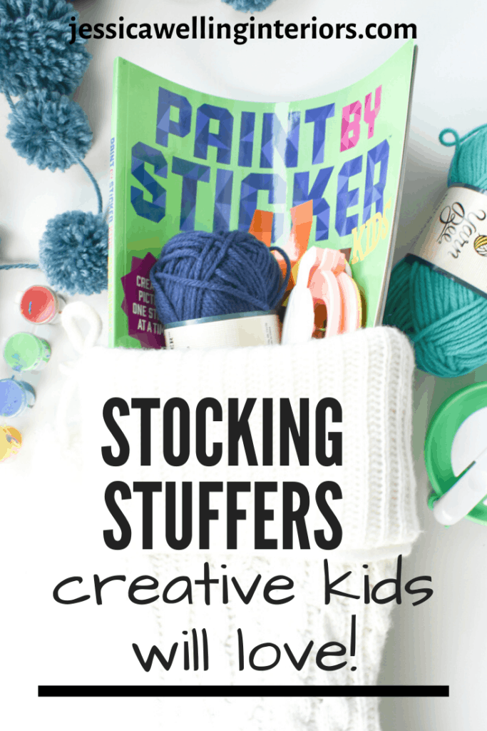 Stocking Stuffers Creative Kids Will Love: white Christmas stocking filled with a sticker book, yarn, pompom makers, and paint