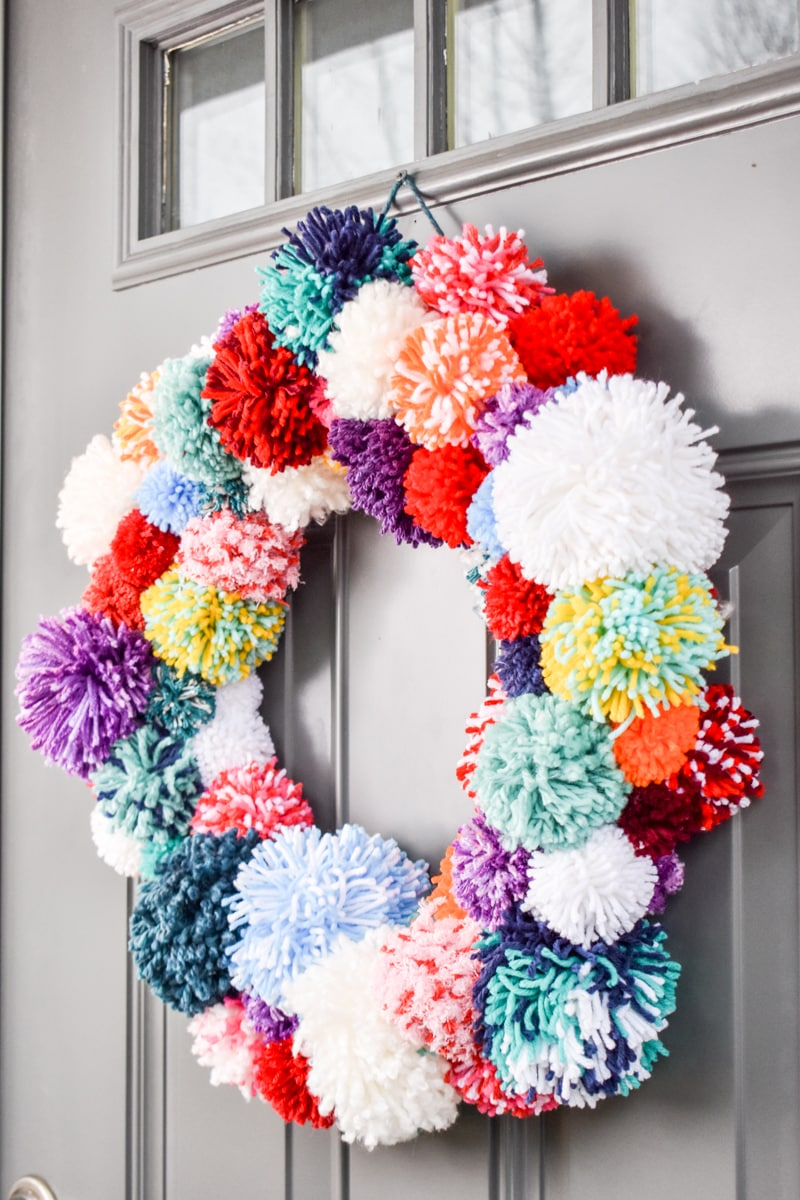 Make a Colorful Pom Pom Wreath!