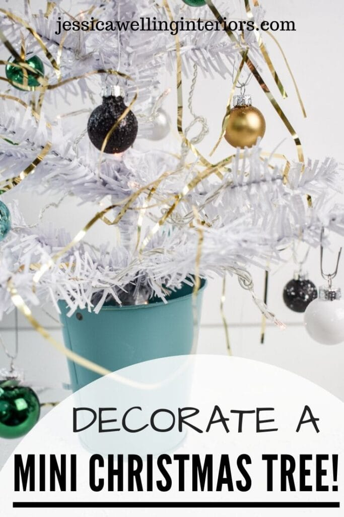 Decorate a Mini Christmas Tree!: close-up of mini dollar store Christmas tree with flocking, ball ornaments, and gold tinsel