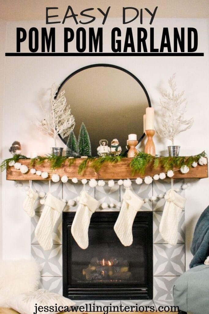 Easy DIY Pom Pom Garland: modern farmhouse mantel decorated for Christmas with a  yarn pom pom garland, cedar boughs, and birds