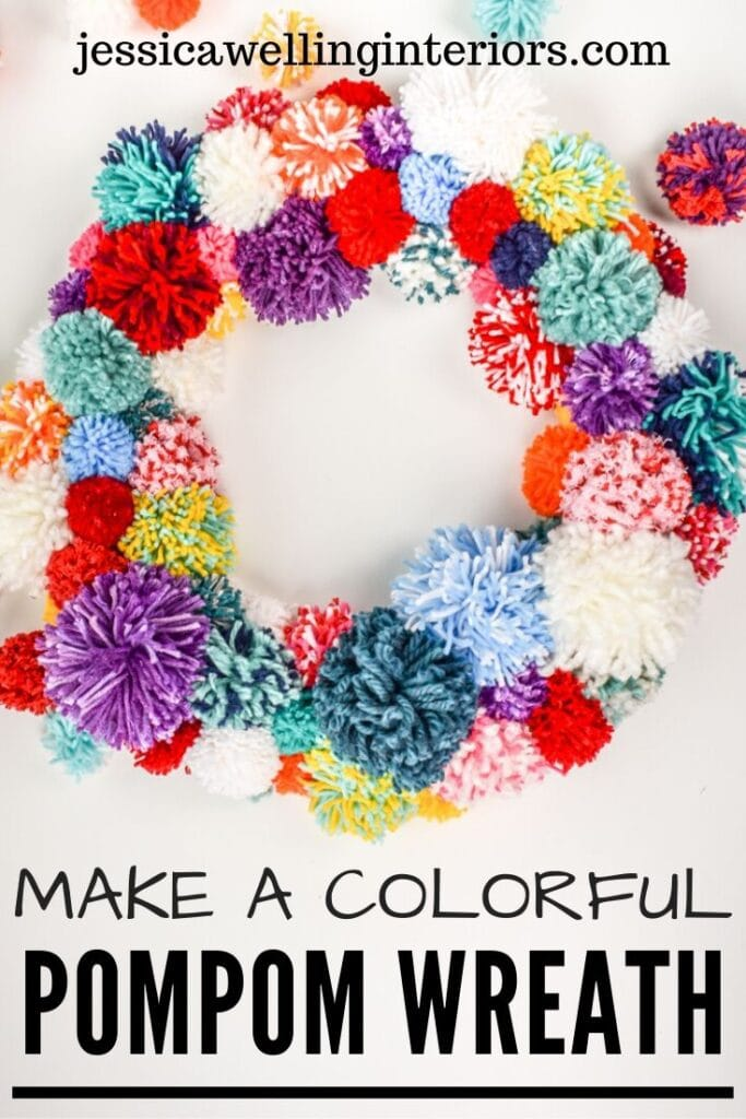 Make a Colorful Pompom Wreath!: brightly colored pom pom wreath on a white background