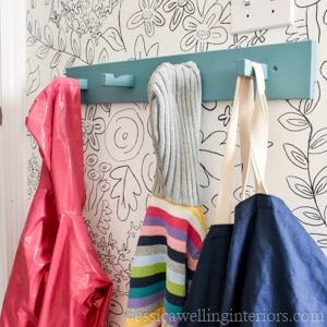 rack of coat hooks on diy wall mural
